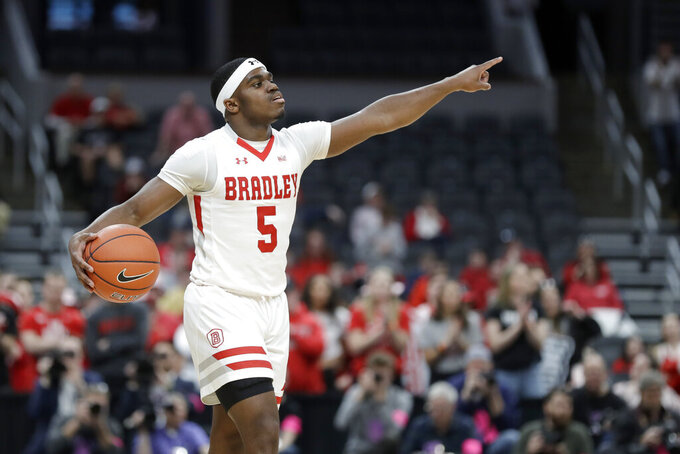 Bradley's Darrell Brown Jr. points during the first half of an NCAA college basketball game against Valparaiso in the championship of the Missouri Valley Conference men's tournament Sunday, March 8, 2020, in St. Louis. (AP Photo/Jeff Roberson)