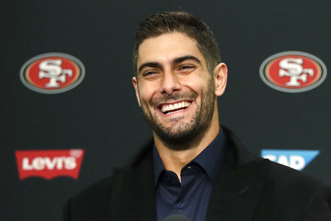 San Francisco 49ers quarterback Jimmy Garoppolo smiles during a news conference after an NFL football game against the Seattle Seahawks, Sunday, Dec. 29, 2019, in Seattle. The 49ers won 26-21. (AP Photo/Stephen Brashear)