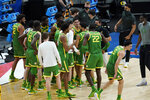 Oregon players celebrate following a second-round game against Iowa. in the NCAA men's college basketball tournament at Bankers Life Fieldhouse, Monday, March 22, 2021, in Indianapolis. Oregon won 95-80. (AP Photo/Darron Cummings)