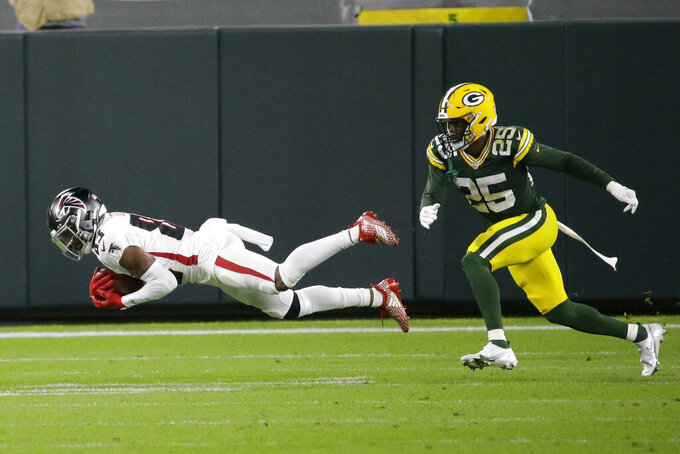 Atlanta Falcons' Russell Gage (83) makes a catch against Green Bay Packers' Will Redmond (25) during the first half of an NFL football game, Monday, Oct. 5, 2020, in Green Bay, Wis. (AP Photo/Mike Roemer)