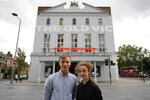 """Actors Patsy Ferran, right and Luke Thallon, stars of the play Camp Siegfried, pose for a photographer in front of the Old Vic theatre in London, Friday, Sept. 10, 2021.  London's Old Vic Theatre is reopening at full capacity for the first time since the pandemic began. The show is """"Camp Siegfried,"""" American writer Bess Wohl's play about a summer camp for Nazis on New York's Long Island. It's based on a real-life camp in the 1930s that indoctrinated young German-Americans into the ideas of the Third Reich, and depicts two teenagers whose burgeoning relationship collides with the insidious ideology of Nazism. (AP Photo/Frank Augstein)"""