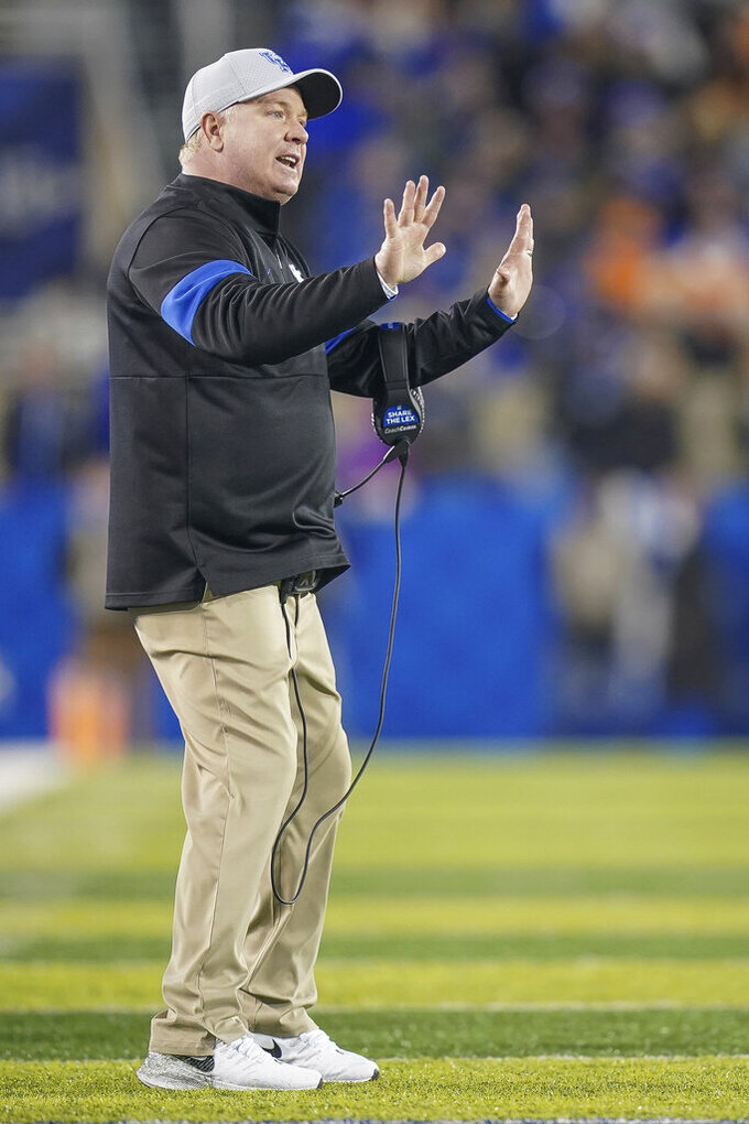 Kentucky coach Mark Stoops signals to players during the first half of an NCAA college football game against Tennessee, Saturday, Nov. 9, 2019, in Lexington, Ky. (AP Photo/Bryan Woolston)