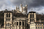 The Saint-Jean Cathedral, foreground, and the Fourviere Basilica, top, are pictured in Lyon, central France, Thursday, March 7, 2019. France's top catholic official Cardinal Philippe Barbarin said he will offer his resignation to Pope Francis, after a court found him guilty of failing to report allegations of sexual abuse of minors by a priest. (AP Photo/Laurent Cipriani)