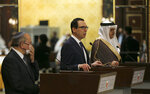 U.S. Treasury Secretary Stephen Mnuchin speaks after an Israeli delegation signed an agreement with Bahraini officials in Manama, Bahrain, Sunday, Oct. 18, 2020. President Donald Trump on Monday, Oct. 19, 2020 said Sudan will be removed from the U.S. list of state sponsors of terrorism if it follows through on its pledge to pay $335 million to American terror victims and families. The decision, announced after Mnuchin was in Bahrain to cement the Gulf state's recognition of Israel, came as the Trump administration pursues further Arab recognition of Israel. (Ronen Zvulun/Pool Photo via AP)
