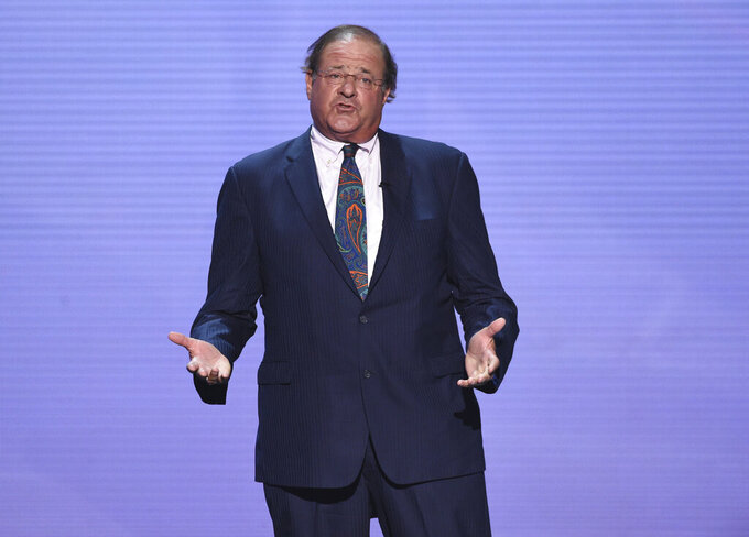 "File-This July 18, 2018, file photo shows shows Chris Berman appearing at the ESPY Awards at Microsoft Theater in Los Angeles.  Berman will continue to host ""NFL PrimeTime"" after agreeing to a new contract with ESPN. The multi-year agreement was announced on Monday, May 10, 2021, which is Berman's 66th birthday. ""We've been working on it for awhile and this was the perfect time to do it,"" Berman said during a telephone interview. ""ESPN has been almost two-thirds of my life. I'm honored that what I do still works.""(Photo by Phil McCarten/Invision/AP, File)"