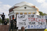 Demonstrators carry banners in front of the Rotunda on the campus of the University of Virginia during a rally for the anniversary of last year's Unite the Right rally in Charlottesville, Va., Saturday, Aug. 11, 2018. (AP Photo/Steve Helber)