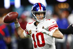 FILE- In this Oct. 22, 2018 file photo, New York Giants quarterback Eli Manning (10) works against the Atlanta Falcons during the first half of an NFL football game in Atlanta. This season Manning will enter his 16th training camp with the New York Giants. (AP Photo/John Bazemore)