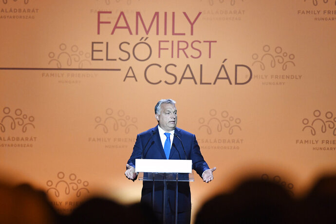 Hungarian Prime Minister Viktor Orban delivers a speech during the 3rd Budapest Demographic Summit in Varkert Bazar conference center in Budapest, Hungary, Thursday, Sept. 5, 2019. The Hungarian capital city, which hosts the international summit for the third time after 2015 and 2017, welcomes politicians, scientists, church dignitaries and public personalities to give presentations and exchange their experiences on current population trends. (Szilard Koszticsak/MTI via AP)