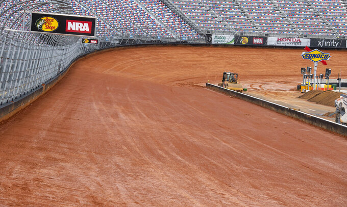 FILE - Bristol Motor Speedway has transformed the half-mile concrete track into a dirt track, in Bristol Tenn., in this Friday, Feb. 19, 2021, file photo.  Bristol, once one of the toughest tickets in sports, trucked 23,000 cubic yards of dirt into its famed bullring to transform the facility and host NASCAR's first Cup race on dirt in 70 years on Sunday, March 28.  (David Crigger/Bristol Herald Courier via AP, File)