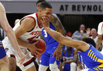 North Carolina State's Jericole Hellems (4) tries to keep the ball from Hofstra's Tareq Coburn (0) during the first half of an NCAA college basketball game in Raleigh, N.C., Tuesday, March 19, 2019. (Ethan Hyman/The News & Observer via AP)