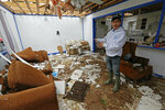 Andres Aguilar, a native of Guatemala, says Friday, April 19, 2019, that he and other family members were very scared when they heard the winds of a possible tornado hit their Morton, Miss., home, Thursday afternoon. Augilar said he and his family hid under the house's door frame as much of the roof and ceiling was torn off and the windows were blown out. Strong storms again roared across the South on Thursday, topping trees and leaving a variety of damage in Mississippi, Louisiana and Texas. (AP Photo/Rogelio V. Solis)
