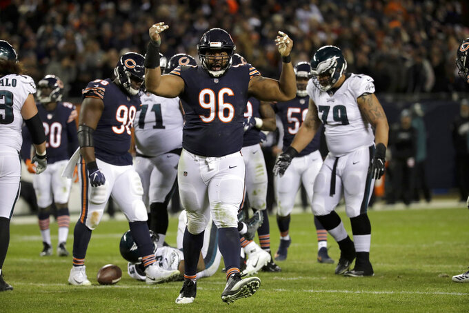 Chicago Bears defensive end Akiem Hicks (96) reacts after tackling Philadelphia Eagles running back Darren Sproles (43) during the second half of an NFL wild-card playoff football game Sunday, Jan. 6, 2019, in Chicago. (AP Photo/Nam Y. Huh)