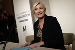 Far-right leader Marine le Pen smiles before a press conference on immigration Tuesday, Sept. 28, 2021 in Paris. Presidential candidate for the 2022 election Marine Le Pen announced plans for an immigration referendum. (AP Photo/Lewis Joly))