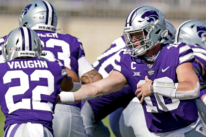 Kansas State quarterback Skylar Thompson (10) hands the ball to running back Deuce Vaughn (22) during the first half of an NCAA college football game against Texas Tech Saturday, Oct. 3, 2020, in Manhattan, Kan. (AP Photo/Charlie Riedel)