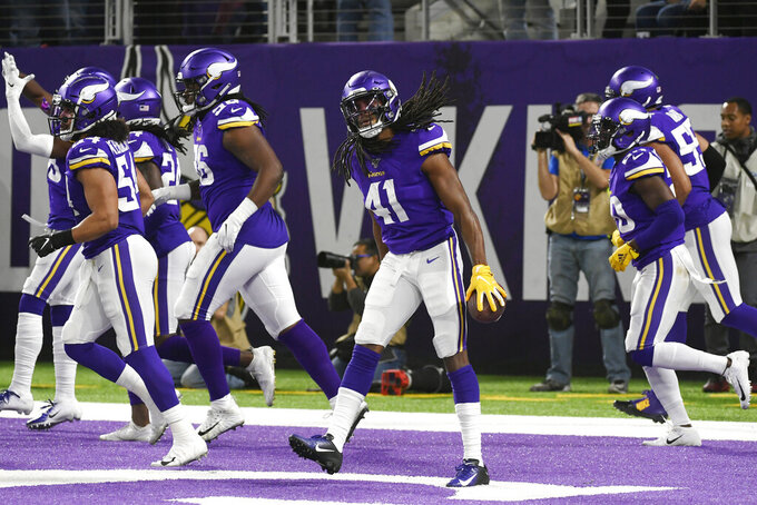 Minnesota Vikings defensive back Anthony Harris (41) celebrates after intercepting a Green Bay Packers pass during the first half of an NFL football game Monday, Dec. 23, 2019, in Minneapolis. (AP Photo/Craig Lassig)