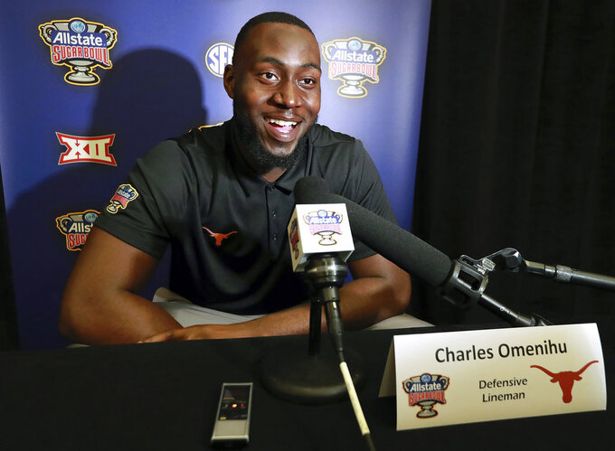 Texas defensive lineman Charles Omenihu takes questions during a news conference, Sunday, Dec. 30, 2018 in New Orleans. No. 6 Georgia, No. 14 Texas meet in Sugar Bowl on Tuesday, Jan., 1, 2019. (Curtis Compton/Atlanta Journal-Constitution via AP)