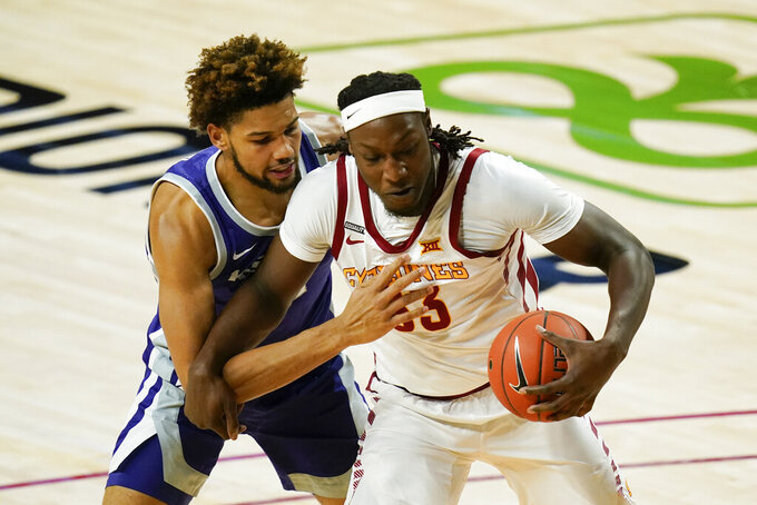 Kansas State forward David Bradford, left, tries to steal the ball from Iowa State forward Solomon Young during the first half of an NCAA college basketball game, Tuesday, Dec. 15, 2020, in Ames, Iowa. (AP Photo/Charlie Neibergall)
