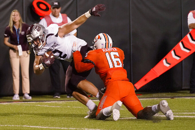 Oklahoma State linebacker Devin Harper (16) tackles Missouri State tight end Ron Tiavaasue (2) during the second half of an NCAA college football game Saturday, Sept. 4, 2021, in Stillwater, Okla. (AP Photo/Sue Ogrocki)