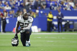 FILE - Jacksonville Jaguars' Leonard Fournette (27) kneels during the second half of an NFL football game against the Indianapolis Colts, Sunday, Nov. 17, 2019, in Indianapolis. The Jacksonville Jaguars have waived running back Leonard Fournette, a stunning decision that gets the team closer to purging Tom Coughlin's tenure.(AP Photo/Michael Conroy, File)