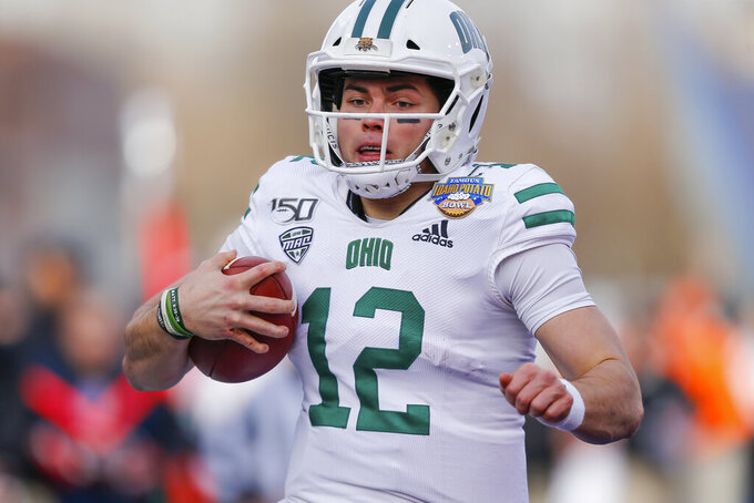 Ohio quarterback Nathan Rourke (12) arrives in the end zone on a 35-yard touchdown run against Nevada in the first half of the Famous Idaho Potato Bowl NCAA college football game Friday, Jan. 3, 2020, in Boise, Idaho. (AP Photo/Steve Conner)