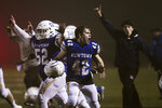 Newtown's Ben Pinto (42) reacts after the Newtown Nighthawks beat the Darien Blue Wave with a walk-off touchdown in the Class LL state football championship at Trumbull High School Saturday, Dec. 14, 2019, in Trumbull, Conn. Newtown won 13-7. Newtown marked the seventh anniversary of the massacre at Sandy Hook Elementary School with vigils, church services and a moment of joy when the community's high school football team, with a shooting victim's brother as linebacker, won the state championship Saturday in a last-minute thrill. (Kassi Jackson/Hartford Courant via AP)