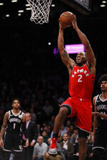 Toronto Raptors forward Kawhi Leonard goes up for a dunk during the first half of the NBA basketball game against the Brooklyn Nets, Wednesday, April 3, 2019, in New York. (AP Photo/Kevin Hagen)