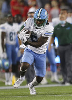 Tulane running back Stephon Huderson carries against Houston during the first half of an NCAA college football game Thursday, Oct. 8, 2020, in Houston. (Yi-Chin Lee/Houston Chronicle via AP)