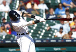 Detroit Tigers' Nicholas Castellanos hits a two-run home run against the Houston Astros in the seventh inning of a baseball game in Detroit, Wednesday, Sept. 12, 2018. (AP Photo/Paul Sancya)