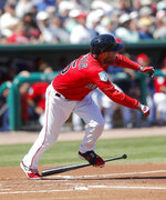 Boston Red Sox second baseman Dustin Pedroia runs to first base on a single in the first inning of a spring training baseball game against the Minnesota Twins Thursday, March 7, 2019, in Fort Myers, Fla. (AP Photo/John Bazemore)