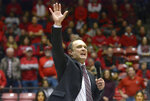 Danny Gonzales, a former New Mexico assistant coach and player, greets fans during a halftime introduction at an NCAA college basketball game between New Mexico and Grand Canyon, Tuesday, Dec. 17, 2019, in Albuquerque, N.M. Gonzales is set to become the 32nd head coach of the football team. (Greg Sorber/The Albuquerque Journal via AP)