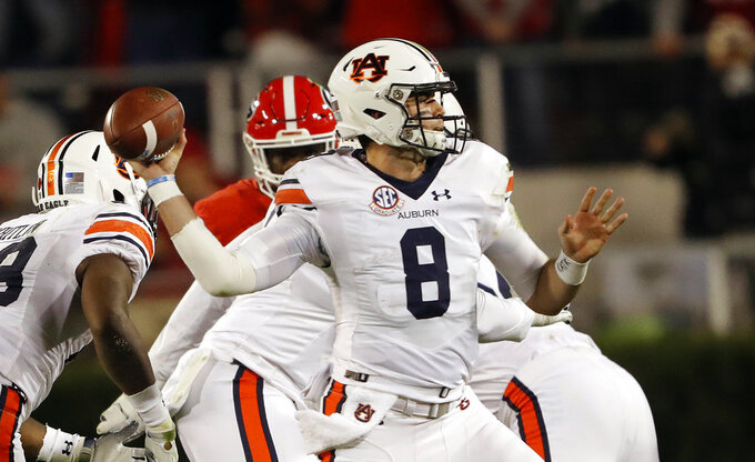 Auburn quarterback Jarrett Stidham (8) looks to throw a pass during the first half of an NCAA college football game against Georgia Saturday, Nov. 10, 2018, in Athens, Ga. (AP Photo/John Bazemore)