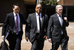 Former Reading Mayor Vaughn Spencer, center, departs from the federal courthouse in Philadelphia after being sentenced to eight years in prison for trading city contracts for campaign contributions on Wednesday, April 24, 2019. (AP Photo/Matt Rourke)