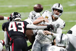 Atlanta Falcons linebacker Mykal Walker (43) hits Las Vegas Raiders quarterback Derek Carr (4) during the second half of an NFL football game, Sunday, Nov. 29, 2020, in Atlanta. Carr through an interception on the play. (AP Photo/John Bazemore)