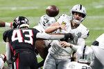 Atlanta Falcons linebacker Mykal Walker (43) hits Las Vegas Raiders quarterback Derek Carr (4) during the second half of an NFL football game, Sunday, Nov. 29, 2020, in Atlanta. Carr through an interception on the play. (AP Photo/John Bazemore)