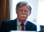 FILE - In this April 9, 2018, file photo, National Security Adviser John Bolton listens as President Donald Trump speaks during a cabinet meeting at the White House in Washington. After announcing early Wednesday that it was pulling out of high-level talks with Seoul because of a new round of U.S.-South Korea military exercises, the North took aim at Bolton and said it might have to reconsider whether to proceed with the summit between Trump and North Korean leader Kim Jong Un because it doubts how seriously Washington actually wants peaceful dialogue. (AP Photo/Evan Vucci, File)