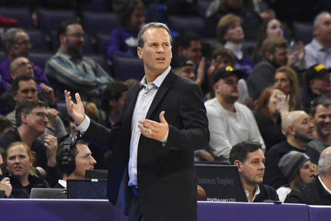 Northwestern coach Chris Collins gestures to the officials during the second half of the team's NCAA college basketball game against Iowa, Tuesday, Jan. 14, 2020, in Evanston, Ill. (AP Photo/David Banks)