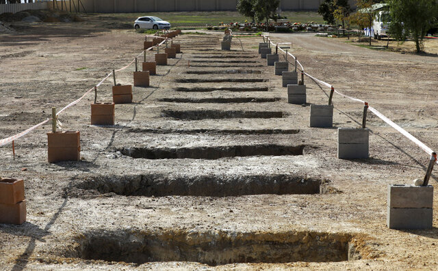 Empty graves are seen at the Durbanville Memorial Park in Cape Town, South Africa, Thursday, May 21, 2020. With dramatically increased community transmissions, Cape Town has become the centre of the coronavirus outbreak in South Africa and the entire continent. (AP Photo/Nardus Engelbrecht)