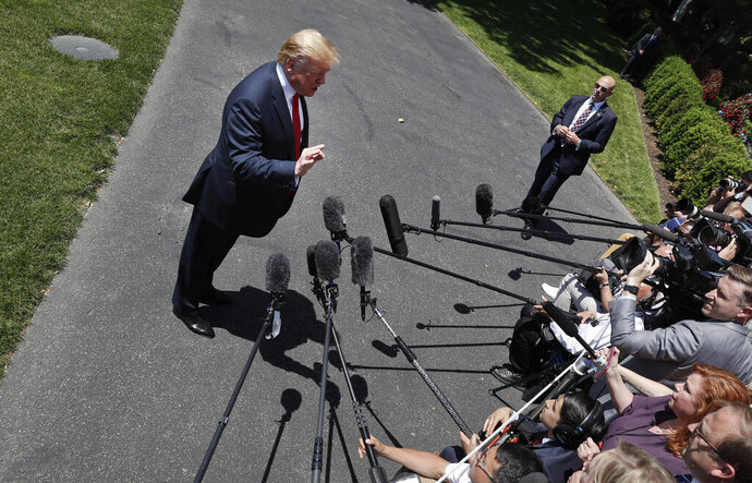 President Donald Trump speaks to members of the media on the South Lawn of the White House in Washington, Friday, May 24, 2019, before boarding Marine One for a short trip to Andrews Air Force Base, Md., and then on to Tokyo. (AP Photo/Pablo Martinez Monsivais)