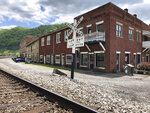 In this Tuesday, May 12, 2020, is a former corner post office in Matewan, W.Va. On May 19, 1920, coal miners, led by a local police chief, and detectives hired by a coal company to evict unionizing miners from their homes were involved in a gun battle on the street. Ten people died in the Matewan Massacre. (AP Photo/John Raby)