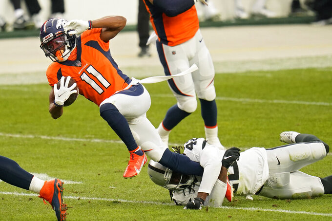 Las Vegas Raiders outside linebacker Cory Littleton (42) tackles Denver Broncos wide receiver Diontae Spencer (11) during the first half of an NFL football game, Sunday, Jan. 3, 2021, in Denver. (AP Photo/Jack Dempsey)