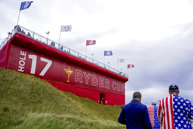 Fans walk on the 17th hole during a practice day at the Ryder Cup at the Whistling Straits Golf Course Thursday, Sept. 23, 2021, in Sheboygan, Wis. (AP Photo/Jeff Roberson)