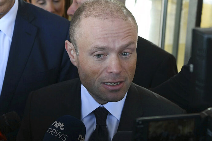 "Malta Prime Minister Joseph Muscat talks to reporters in Valletta, Malta, Wednesday, Nov. 20, 2019. Malta authorities arrested prominent businessman Yorgen Fenech, who appears to be a ""person of interest"" in the assassination of leading investigative reporter Daphne Caruana Galizia, killed by a powerful car bomb in October 2017.  (AP Photo/Jonathan Borg)"