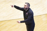 Ohio State head coach Chris Holtmann directs players during the second half of a first-round game against Oral Roberts in the NCAA men's college basketball tournament, Friday, March 19, 2021, at Mackey Arena in West Lafayette, Ind. Oral Roberts won in overtime. (AP Photo/Robert Franklin)
