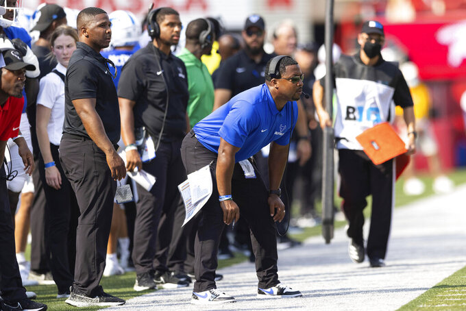 Buffalo head coach Maurice Linguist watches his team from the sideline as they play Nebraska during the first half of an NCAA college football game, Saturday, Sept. 11, 2021, at Memorial Stadium in Lincoln, Neb. (AP Photo/Rebecca S. Gratz)