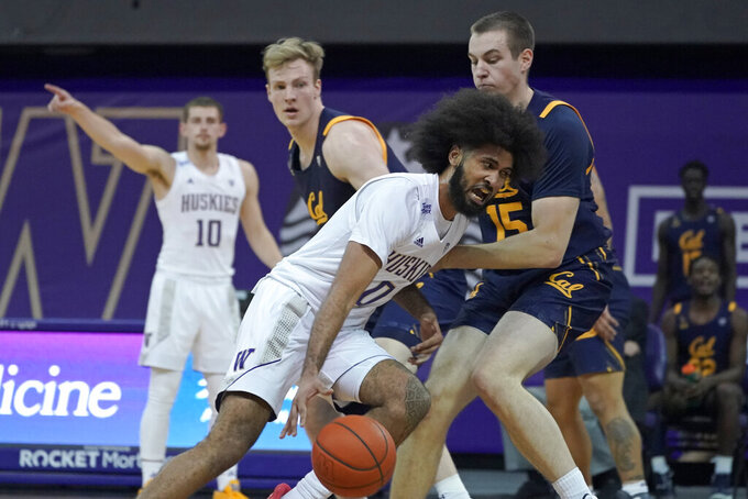 Washington guard Marcus Tsohonis (0) drives against forward Grant Anticevich (15) during the first half of an NCAA college basketball game Saturday, Feb. 20, 2021, in Seattle. (AP Photo/Ted S. Warren)