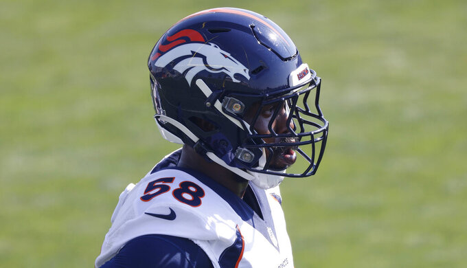 Denver Broncos linebacker Von Miller takes part in drills at the team's NFL football training camp Friday, Aug. 14, 2020, in Englewood, Colo. (AP Photo/David Zalubowski)