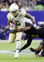Baylor running back JaMycal Hasty (6) is tackled by Vanderbilt defensive back Tae Daley (3) during the first half of the Texas Bowl NCAA college football game Thursday, Dec. 27, 2018, in Houston. (AP Photo/Michael Wyke)