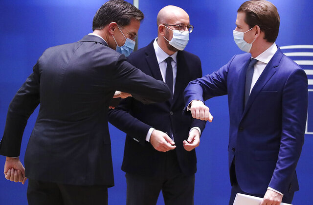 Dutch Prime Minister Mark Rutte, left, greets Austria's Chancellor Sebastian Kurz, right, with an elbow bump during a round table meeting at an EU summit at the European Council building in Brussels, Thursday, Oct. 15, 2020. European Union leaders are meeting in person for a two-day summit amid the worsening coronavirus pandemic to discuss topics ranging from Brexit to climate and relations with Africa. (Yves Herman, Pool via AP)