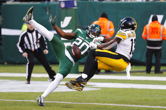 New York Jets free safety Marcus Maye (20) breaks up a pass intended for Pittsburgh Steelers wide receiver James Washington (13) in the second half of an NFL football game, Sunday, Dec. 22, 2019, in East Rutherford, N.J. (AP Photo/Adam Hunger)