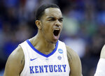 Kentucky's PJ Washington celebrates during the first half of a men's NCAA tournament college basketball Midwest Regional semifinal game against Houston, Friday, March 29, 2019, in Kansas City, Mo. (AP Photo/Charlie Riedel)